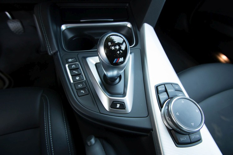 The buttons on the center console where you can adjust the settings for M Engine Dynamics, Adaptive M Suspension, and Servotronic