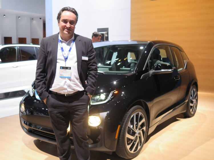 Cliff Fietzek, Manager of Connected eMobility for BMW of North America, stands in front of the special edition Shadow Sport i3 on display at the LA Auto Show