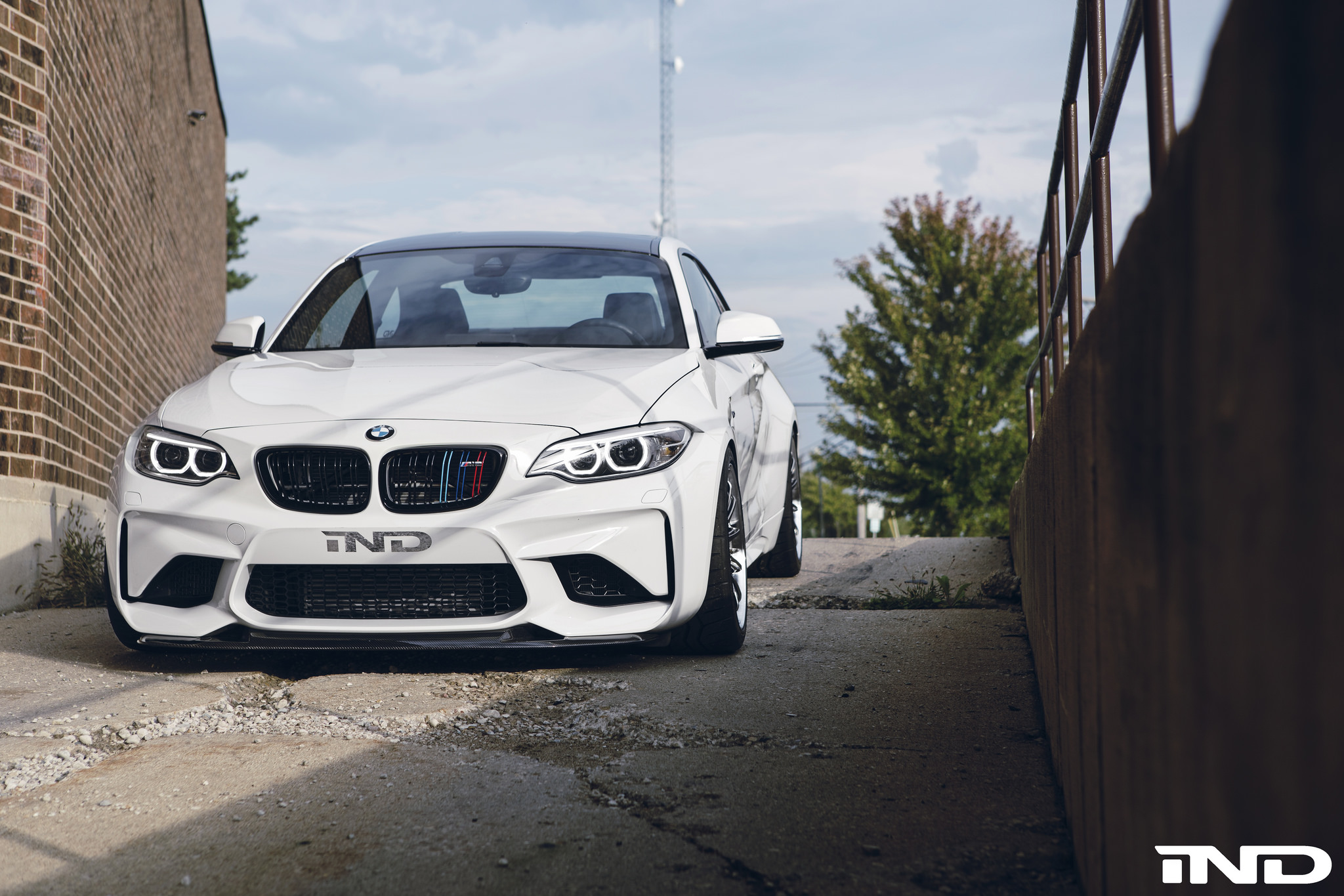A Slammed Alpine White BMW M2 With Carbon Fiber Goodies By IND Distribution 1