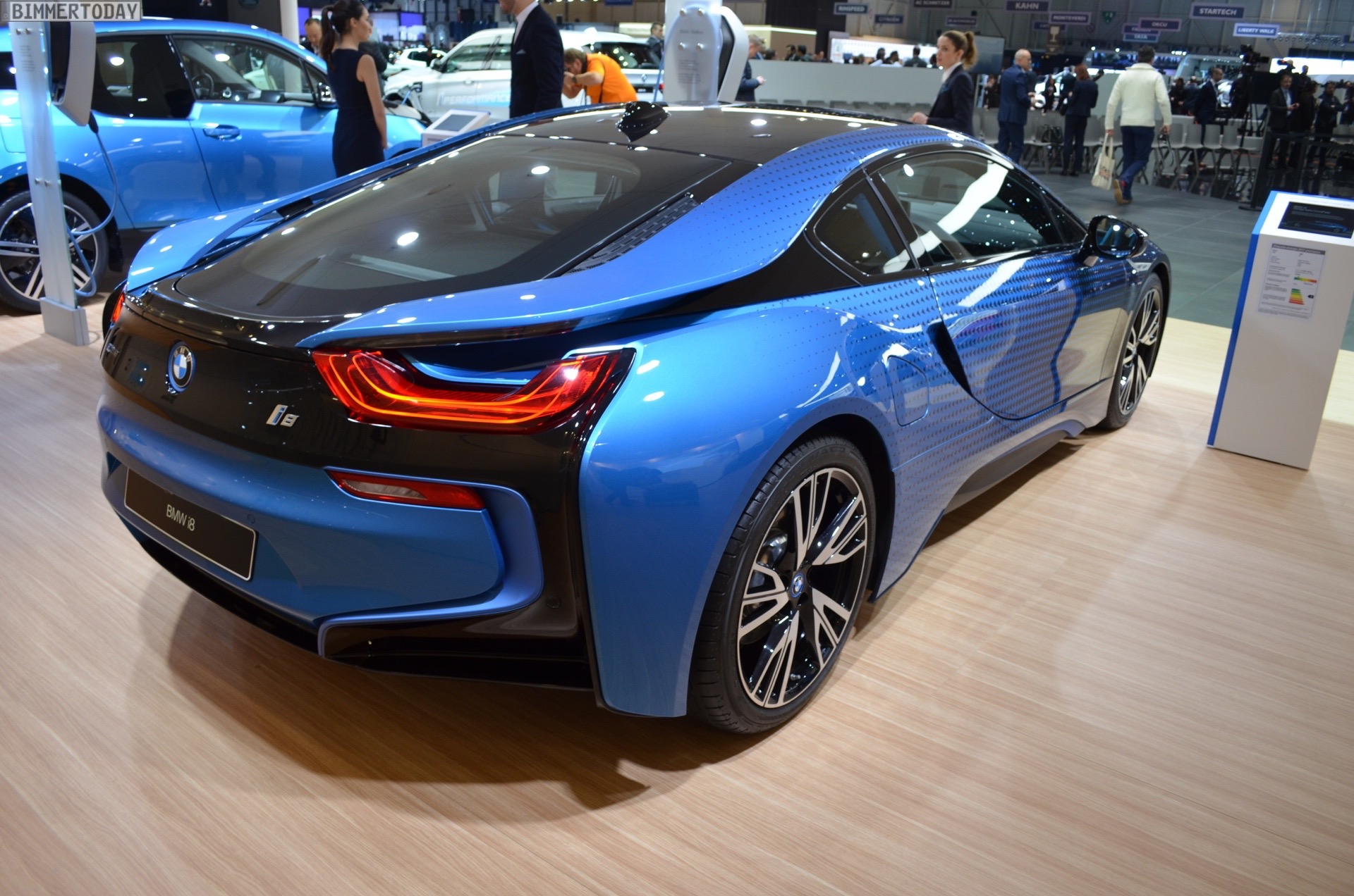On The Body Surface Of BMW I8 Garage Italia CrossFade Accurately Defined Color Changes Between Protonic Blue Metallic And Dark Silver
