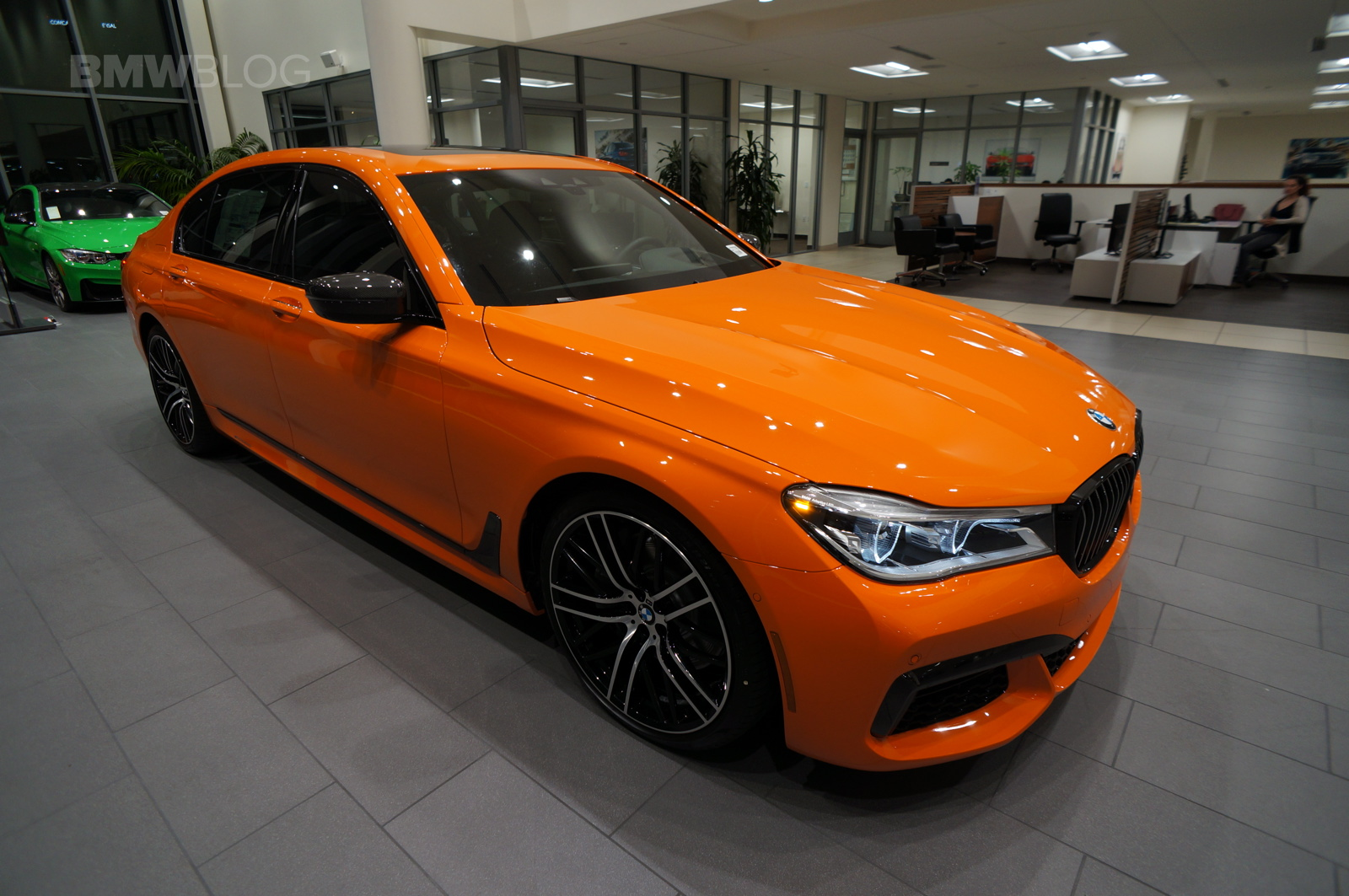 2017 bmw 750i in the unique and flashy fire orange color