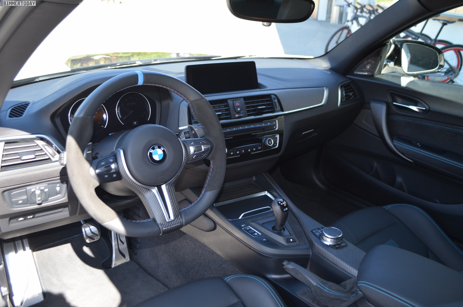 the carbon fiber program continues inside the bmw m2 competition not only the covers for the center console and gear selector are made of carbon fiber