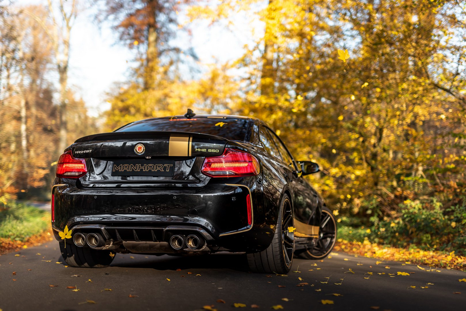 bmw m2 competition gets 550 hp to play with from manhart. Black Bedroom Furniture Sets. Home Design Ideas