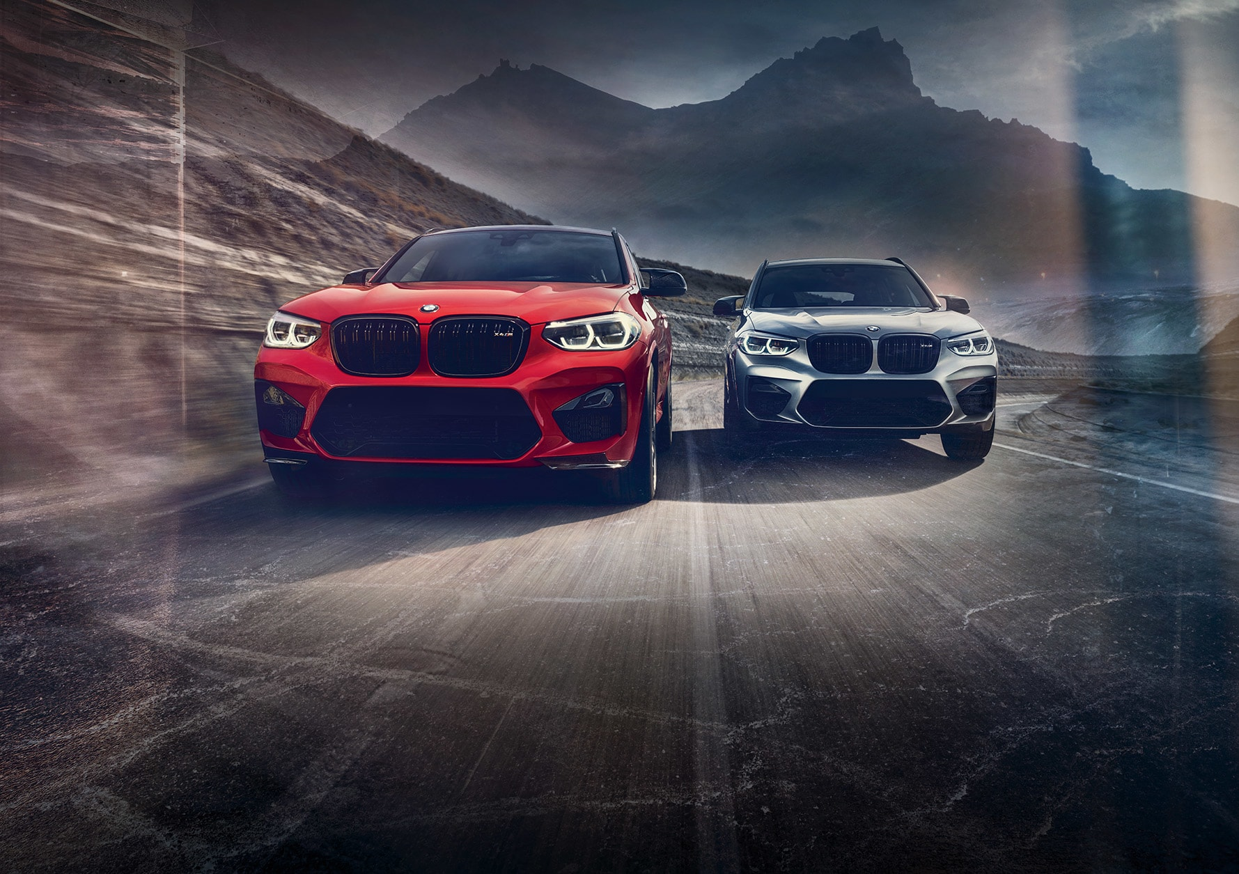 2020 BMW X4 M and X3 M driving on the road 2000