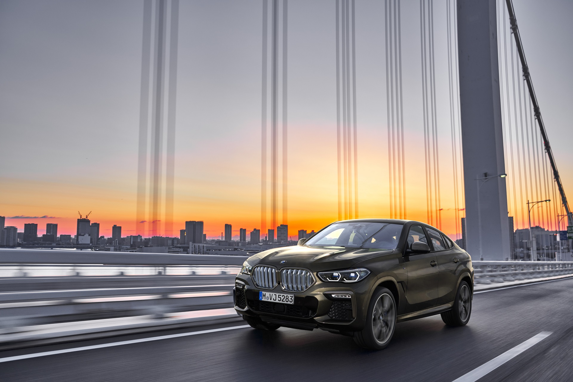 P90356689 highRes the new bmw x6 drivi