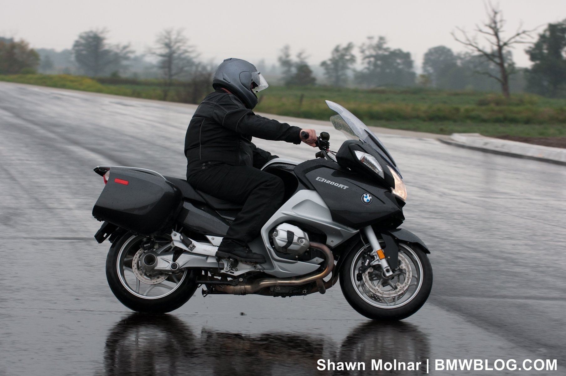 BMW's compact boxer engine allows for steep lean angles, in fact the foot  pegs will scrape before the cylinder head does. On corner entry, the R1200RT  is ...