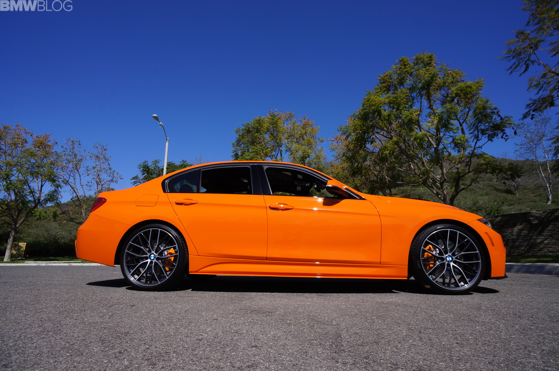 Fire Orange BMW 335i with manual transmission